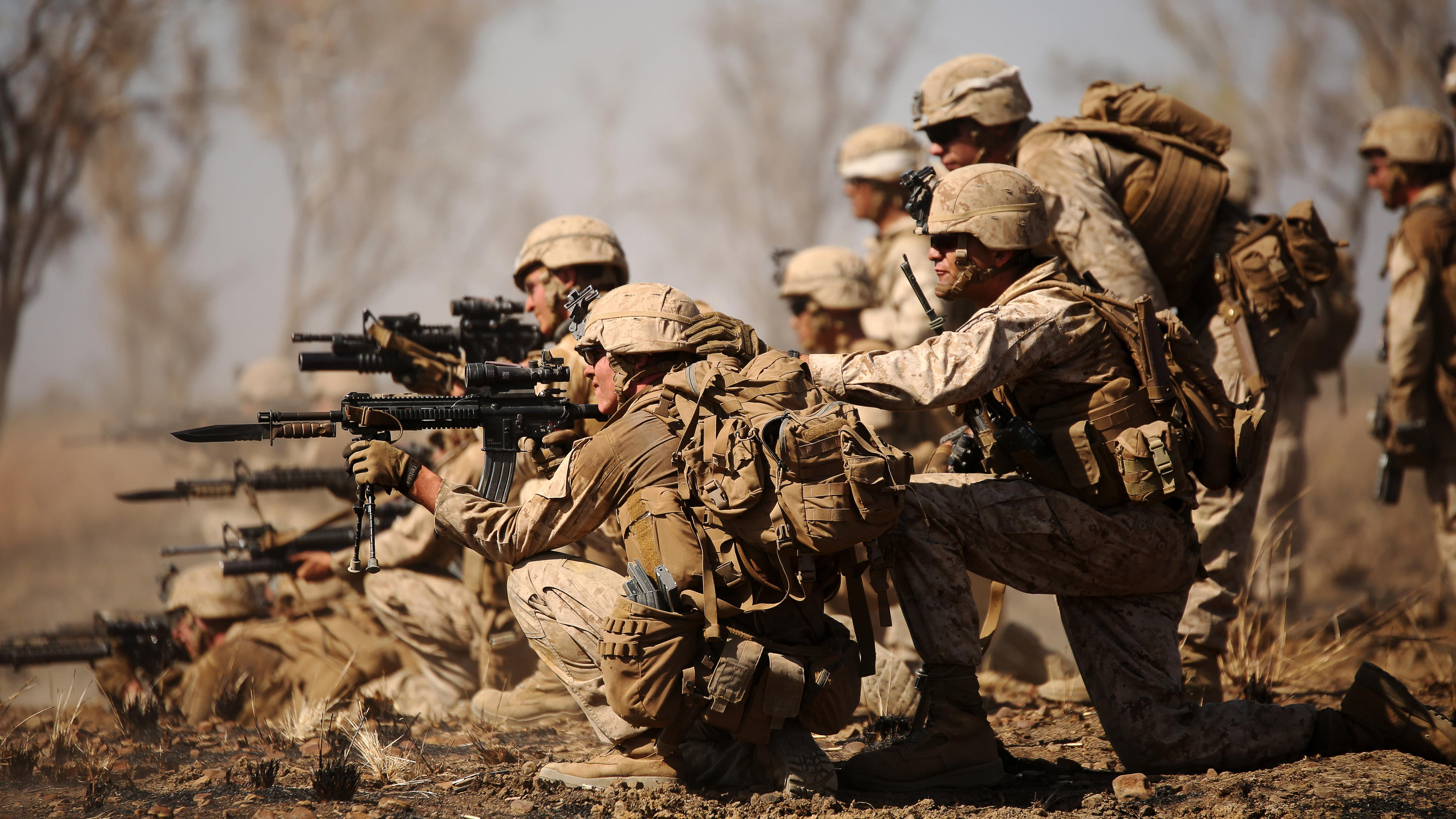 Marines with Company B, 1st Battalion, 1st Marine Regiment, attack an ...
