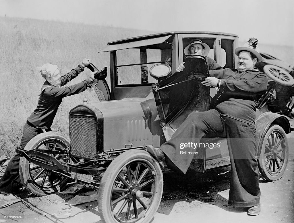 Stan Laurel and Oliver Hardy as sailors, puling the ...