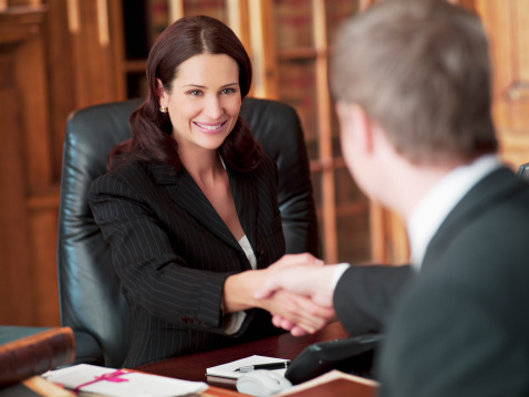 Smiling Lawyers Shaking Hands In Office Stock Photo ...