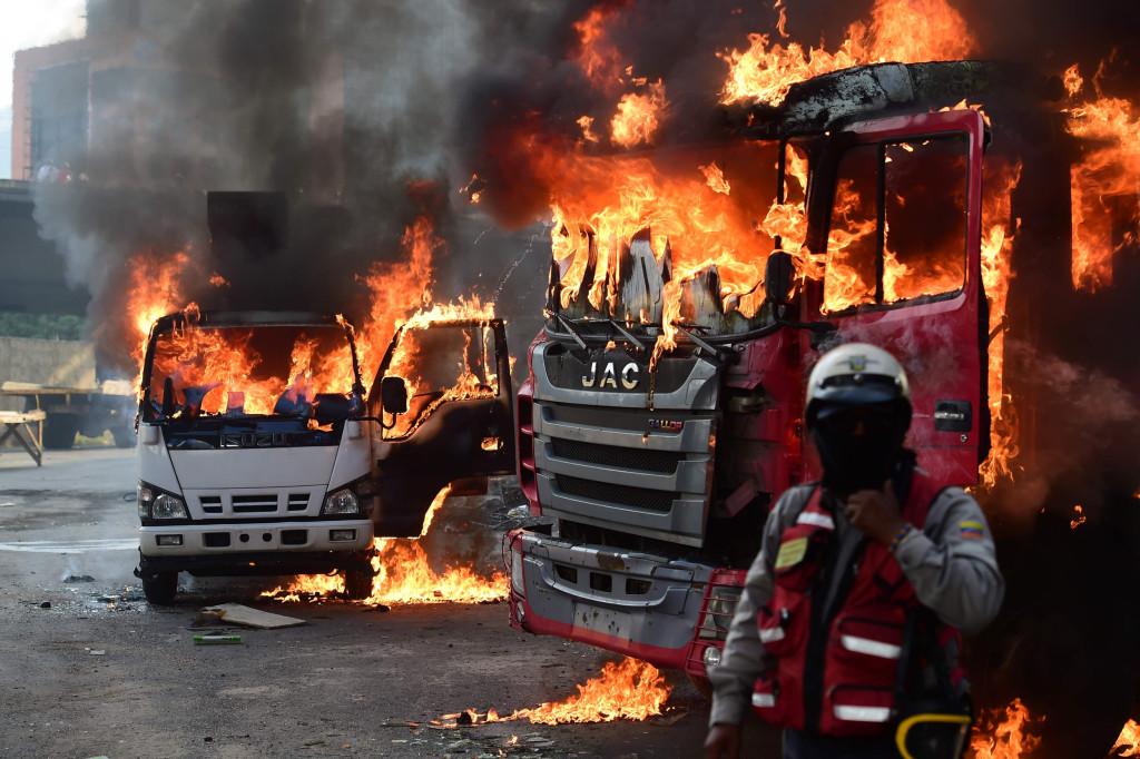 Venezuela's Opposition Activists Protest in Caracas as Unrest Enters ...