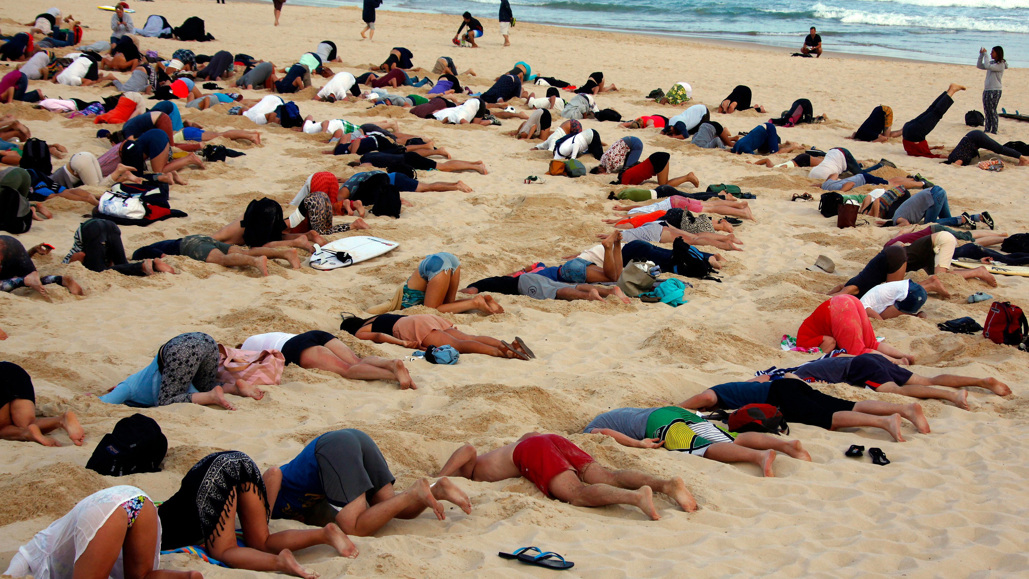 400 People Bury Their Heads in the Sand to Protest Australian Prime Minister's Stance on Climate ...