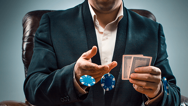 A poker player tossing chips forwards. I know that this is a dice not a cards mechanic, ok, there just weren't good pictures of people shooting dice that made it clear what was going on.
