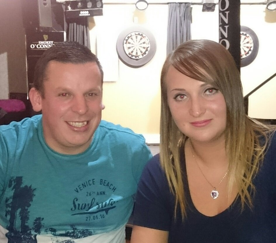 Family photo of the athlete, married to 	Michaela, famous for  Darts.