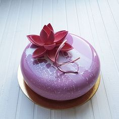 Elegant chocolate mirror glaze cake with pink sugar rose ...