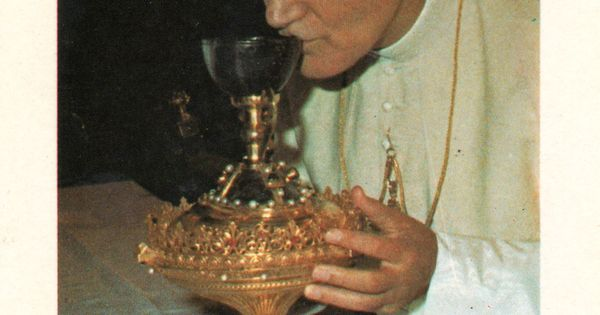 Kissing the Chalice that holds the Precious Body and Blood ...