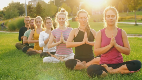 Group of People Meditating at Sunset by Ilya2k | VideoHive