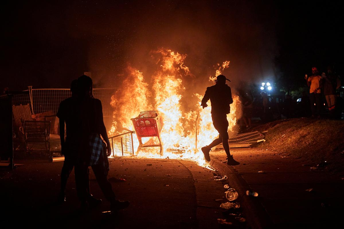 Protests, looting erupt in Minneapolis over racially charged killing by police - Reuters
