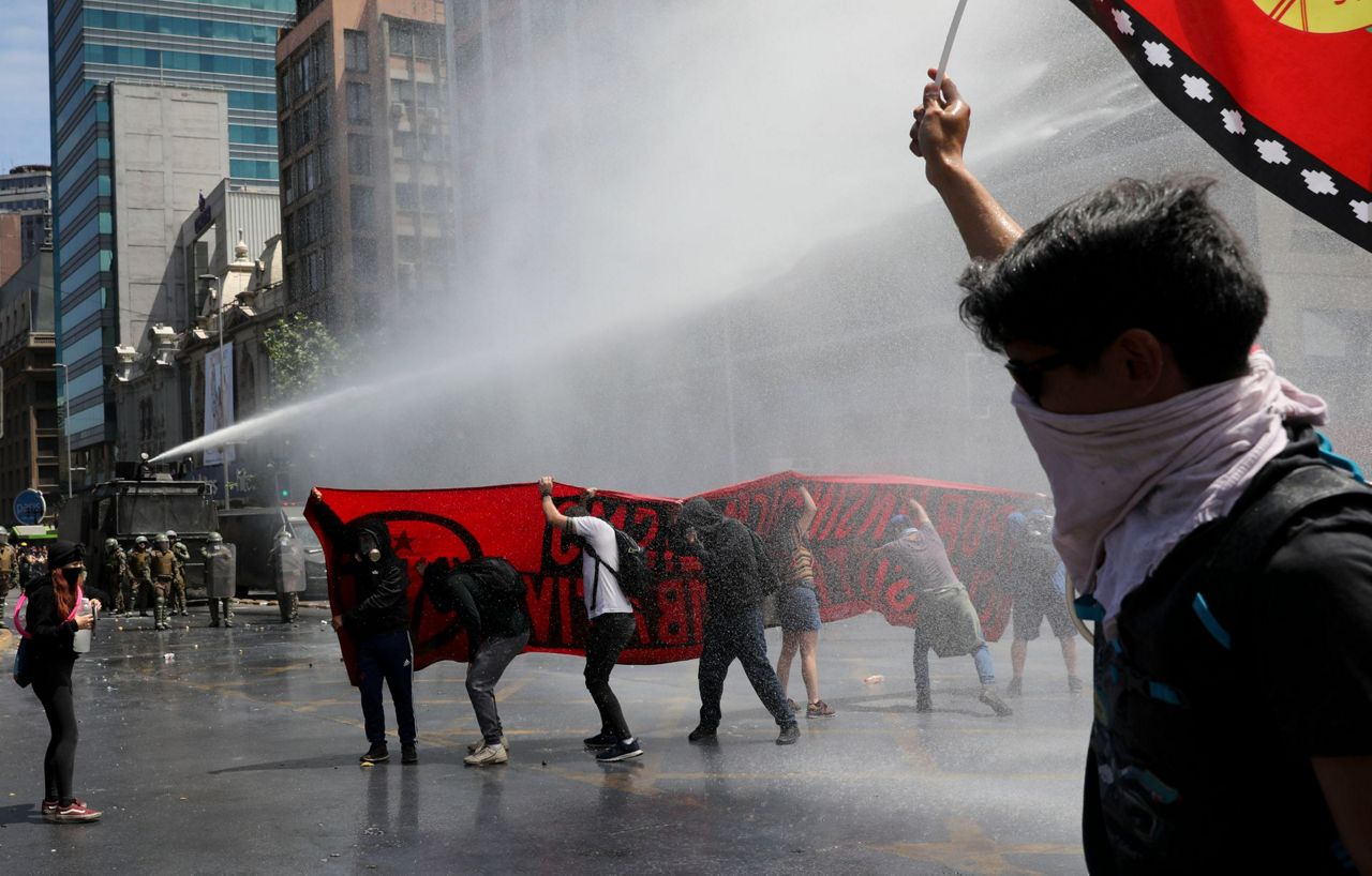 President says sorry but Chile faces more protests, strike