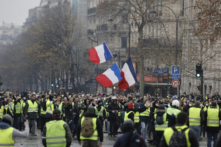 French protesters clash with police in Paris as hundreds ...