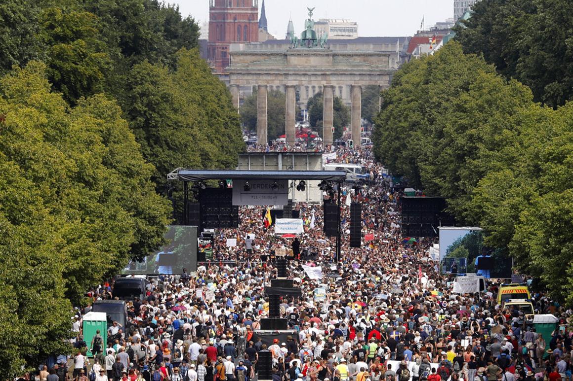 German leaders warn of coronavirus resurgence, condemn ...