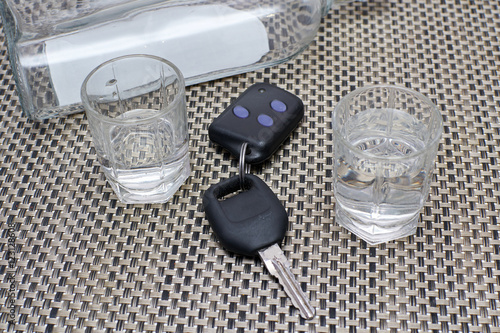 """""""car keys on the table next to full glasses of alcohol and ..."""