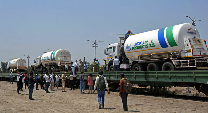 Oxygen Express arriving at a station with filled tankers of life-saving oxygen.
