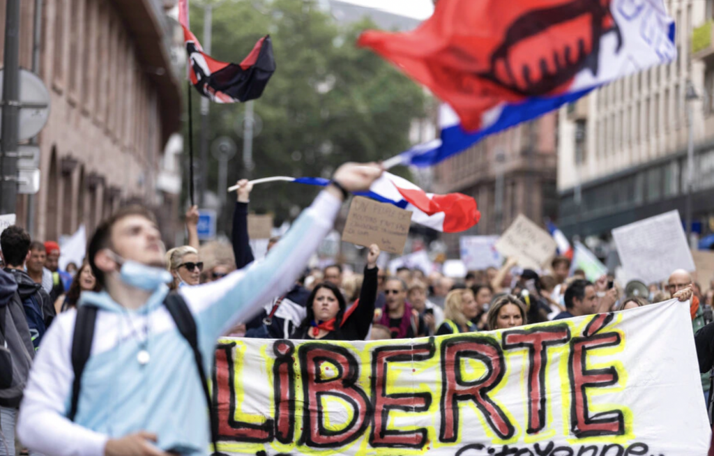 France: Over 100,000 Rally In Opposition To COVID Immunity ...