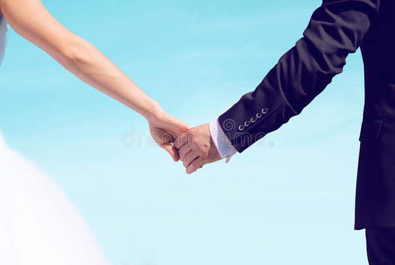 Beautiful Wedding Couple, Bride And Groom Holding Hands Looking Stock Photo - Image of lovers ...