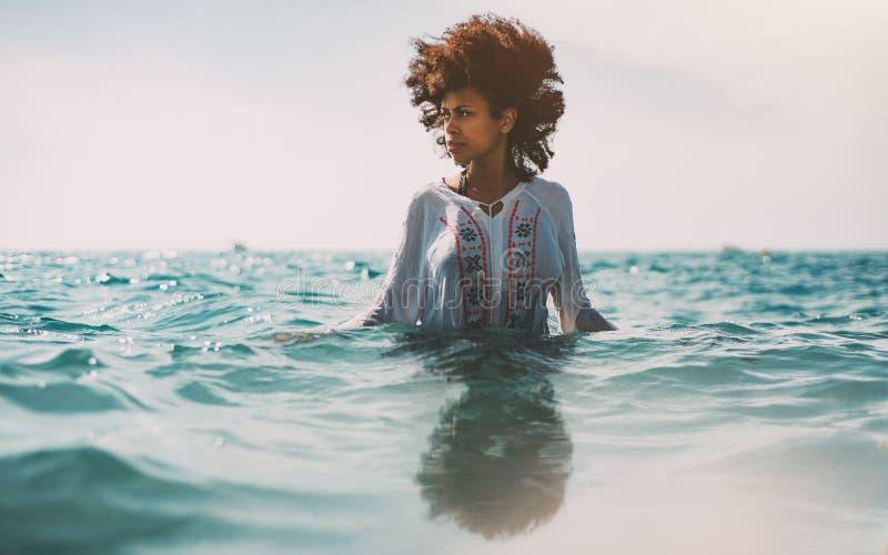 Briacial Girl Standing Waist-deep In Sea Water Stock Image ...