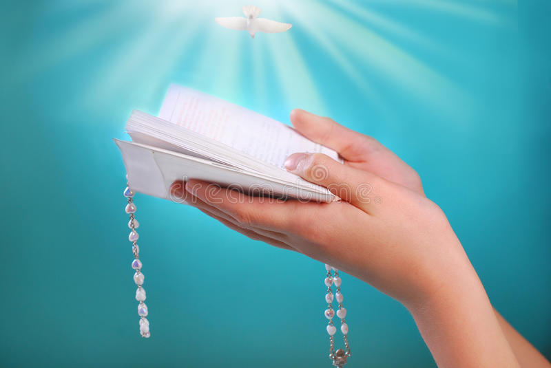 The First Holy Communion With Prayer Book In Hands Stock ...
