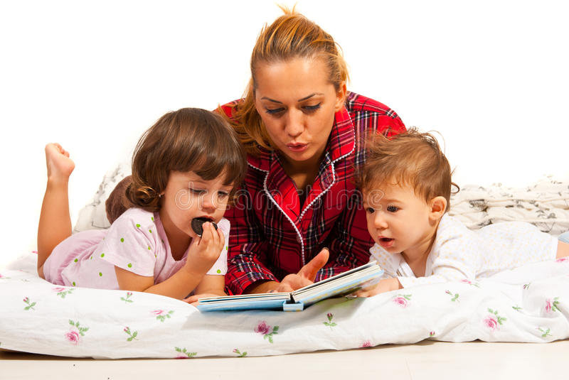 Mom reading bedtime story stock photo. Image of person ...