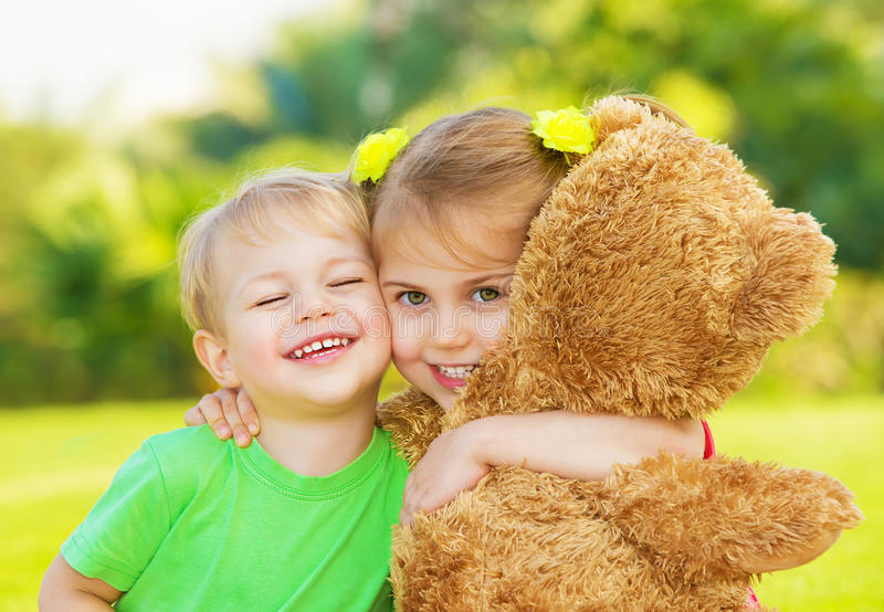 Two little child hugging stock image. Image of outdoor ...