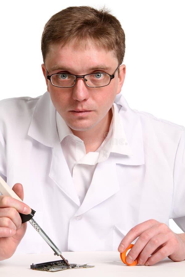 Soldering iron in his hand stock photo. Image of repair ...