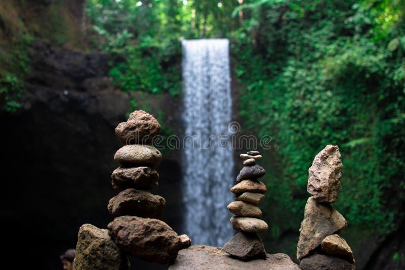 https://external-content.duckduckgo.com/iu/?u=https%3A%2F%2Fthumbs.dreamstime.com%2Fb%2Fstone-stacked-pyramid-desires-built-stones-waterfall-bali-symbol-faith-miracle-twindeafessen-norway-134694617.jpg&f=1&nofb=1