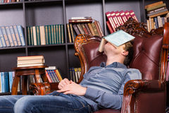 Exhausted Student Sleeping Over Books Stock Images - Image: 25222634