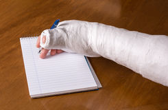 Person With An Arm Cast Writing A Note Stock Image - Image of pain, home: 82120077