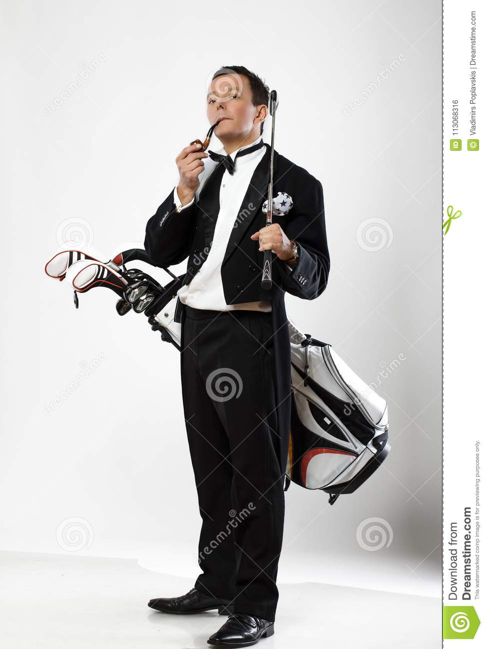 Happy Man In Dinner Suit Holds Golf Club. Stock Photo ...