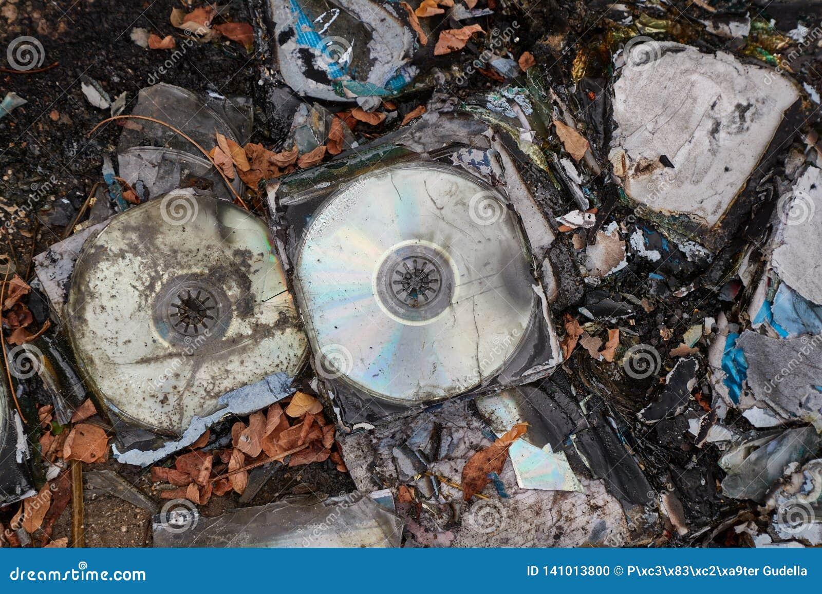 CD`s Thrown Away In Garbage Dump Piles Stock Photo - Image ...