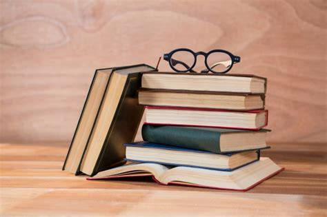 Various books with spectacles on a table Photo | Free Download