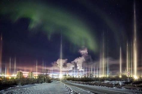 Rare vertical 'light pillar' auroras loom in the sky over ...