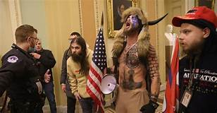 Where have you seen this guy before? 'QAnon Shaman,' in horned hat, stood front and center in ...