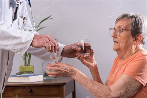 Elderly woman taking medication — Stock Photo © thodonal ...