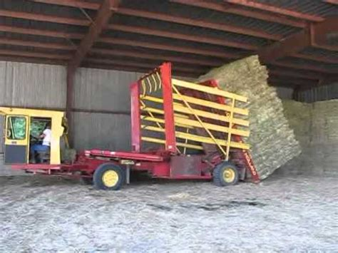 Stacking Square Bales w/1089 New Holland - YouTube