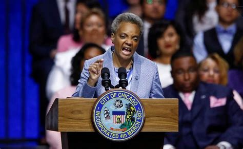 Lori Lightfoot sworn in as Chicago's first black woman and ...