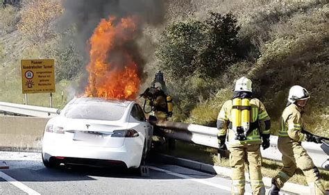 Tesla Model S - electric car catches fire after crashing into motorway barrier | Express.co.uk