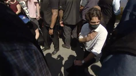Trudeau gets heckled, kneels before protesters   True North