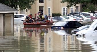 More than 1,200 residents were rescued from floods (pictured; a rescue ...