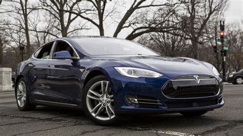 Authorities investigate after Tesla car catches fire - BBC News
