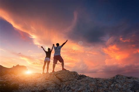 Silhouette Of Happy People On The Mountain Stock Photo ...