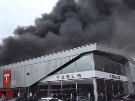Crawley Tesla fire: Explosions reported as blaze rips through showroom | The Independent