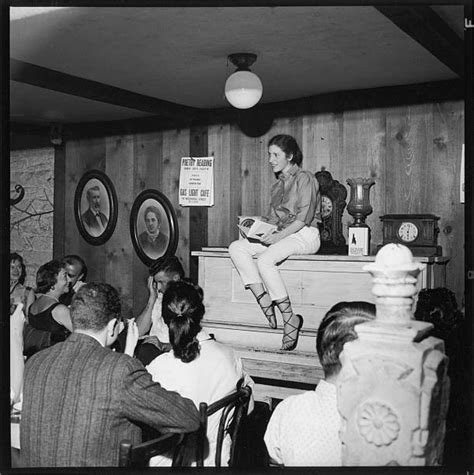 Diane di Prima sits atop a piano and reads from her ...