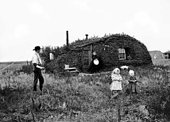 Norwegian settlers in 1898 North Dakota in front of their homestead, a ...