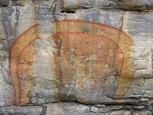 Rainbow Serpent painted on a cave wall by Aboriginal artists.