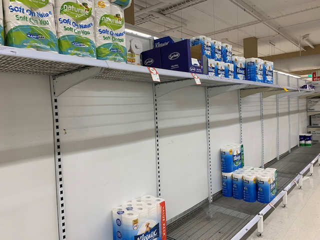 Photos of empty shelves, long lines at grocery stores ...