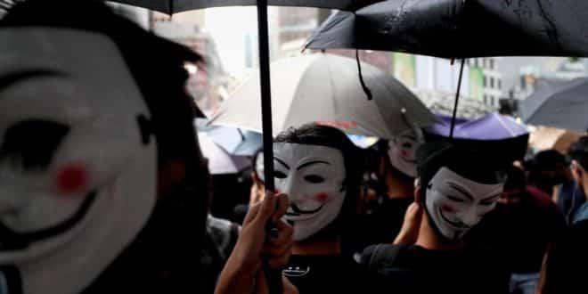 Reconnaissance faciale : Hong-Kong interdit les masques ...