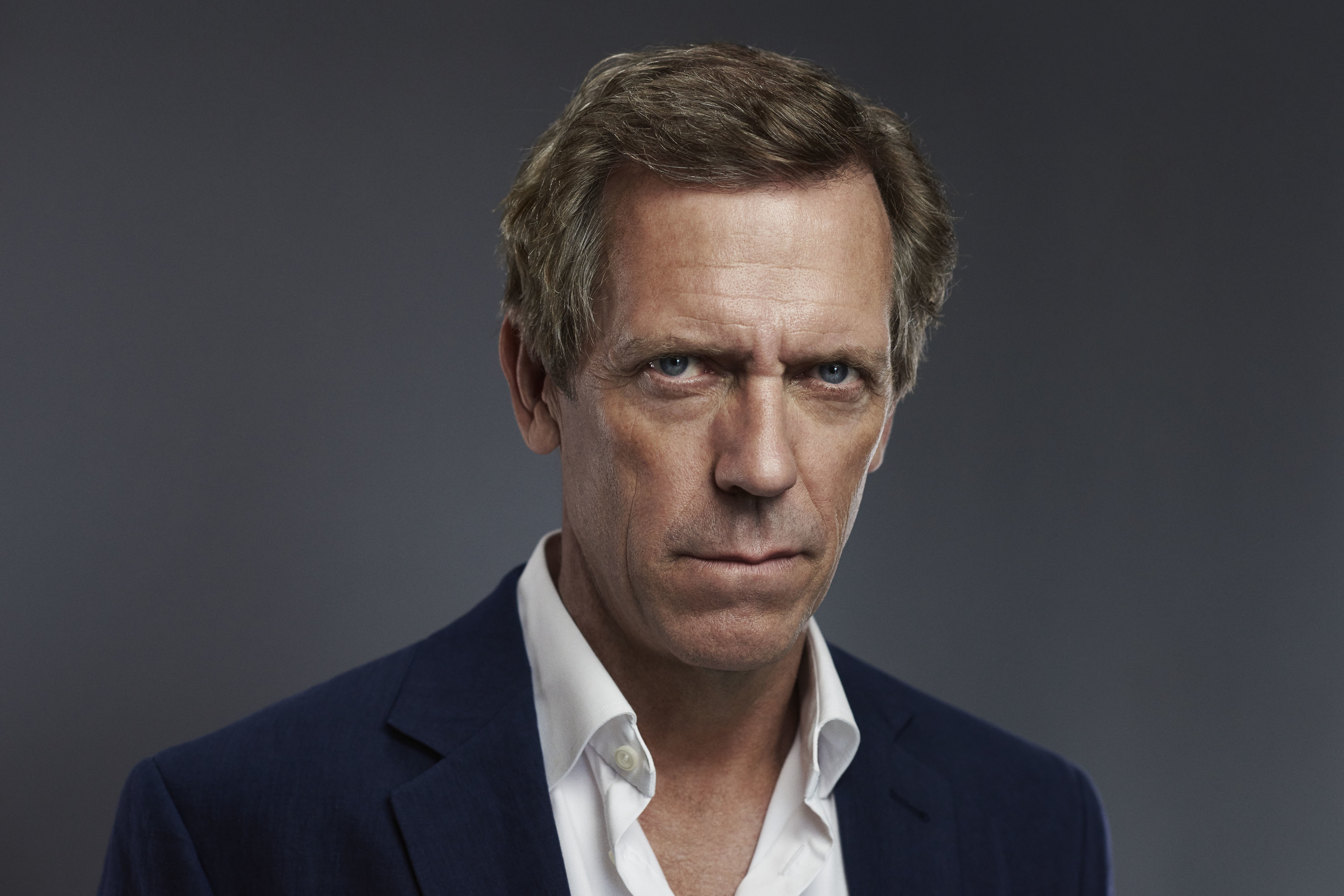 The 58-year old son of father (?) and mother Patricia, 185 cm tall Hugh Laurie in 2018 photo