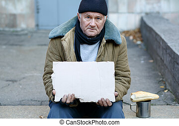 homeless-man-holding-a-cardboard-sign-se